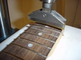 Guitar fret press